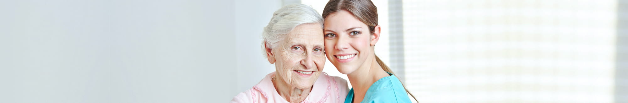female caregiver with senior woman smiling