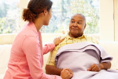 caregiver and senior man having a conversation